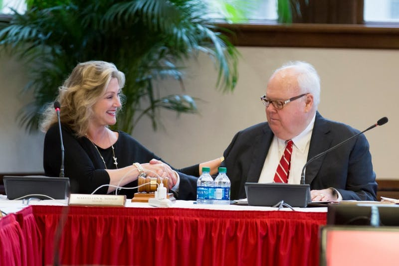 Trustees MaryEllen Bishop and James Morris shake hands. Bishop was reelected to her position in the IU Board of Trustees election June 28.