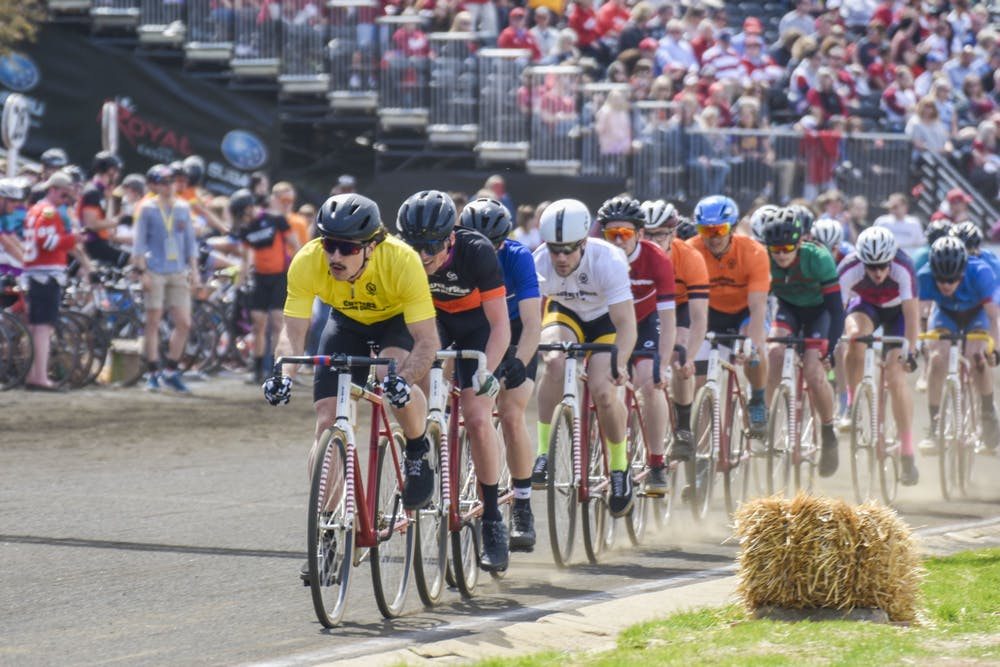 <p>The pack rides down the straight April 13, 2019, during the Little 500 race at Bill Armstrong Stadium. The 2020 men&#x27;s and women&#x27;s Little 500 has been canceled to help combat the spread of COVID-19, according to an email from IU President Michael A. McRobbie.</p>