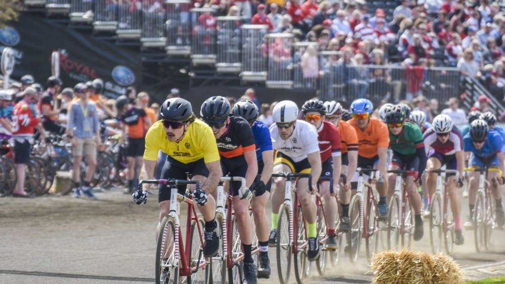 The pack rides down the straight April 13, 2019, during the Little 500 race at Bill Armstrong Stadium. The 2020 men's and women's Little 500 has been canceled to help combat the spread of COVID-19, according to an email from IU President Michael A. McRobbie.