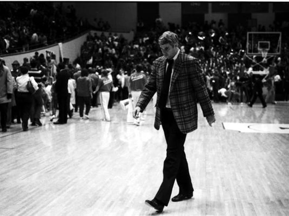 Bob Knight walks on the court Jan. 12, 1985, during a game against Wisconsin at Simon Skjodt Assembly Hall. IU finished the season with a three-point loss to the University of California, Los Angeles in the NIT Championship game.