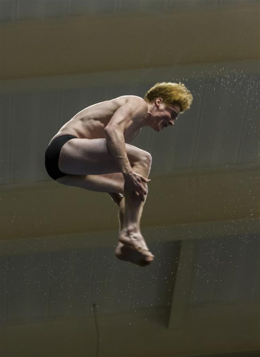 Junior Conor Murphy dives in the Big Ten Swimming and Diving Championships on March 1 in Bloomington. Murphy earned a spot at the NCAA Championships, which is set to begin this coming weekend at IUPUI in Indianapolis.