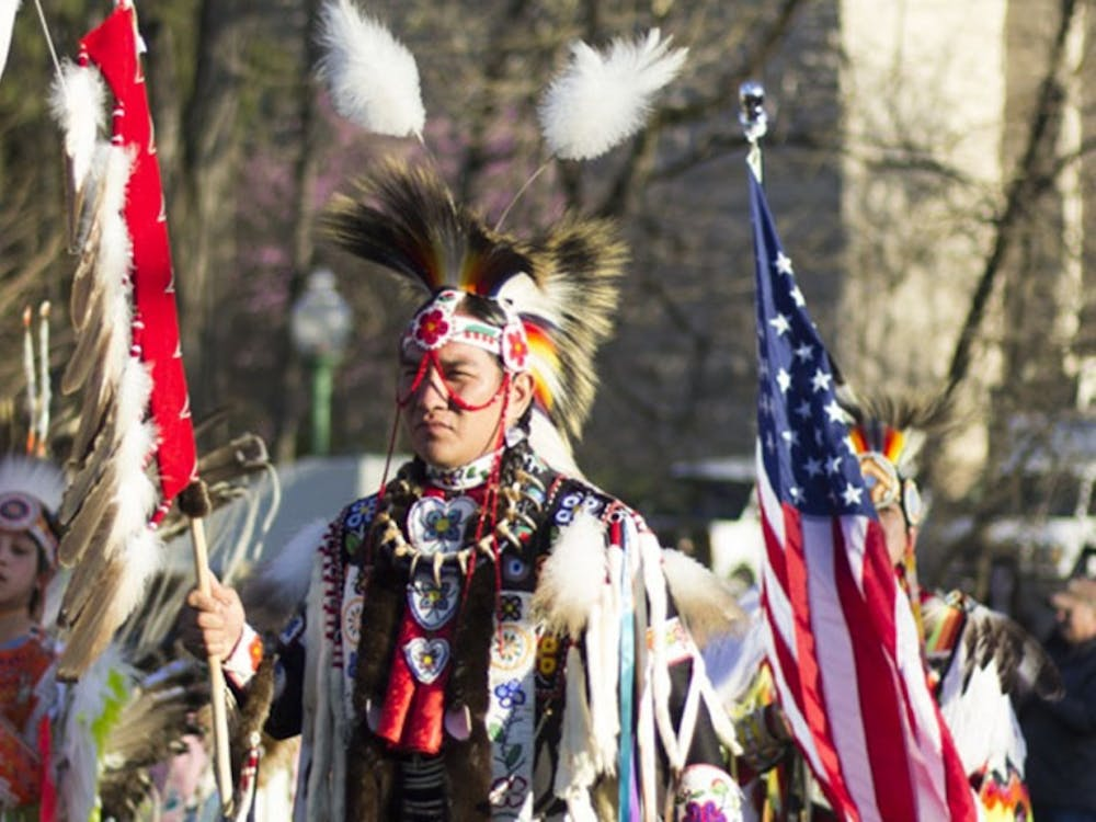 Performers stand during the First Nations Traditional Powwow on April 9, 2017, in Dunn Meadow.