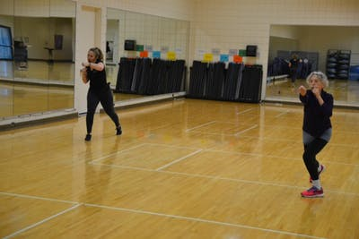 Program Coordinator for Group Exercise Julie Nolan leads a kickboxing class Nov. 9 in the Student Recreational Sports Center.