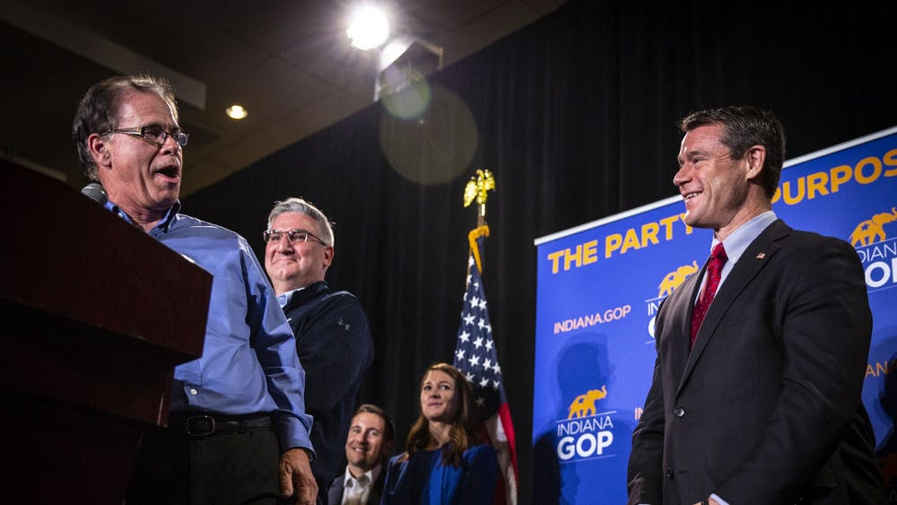 Sen. Mike Braun, R-Ind., Indiana Gov. Eric Holcomb and Sen. Todd Young, R-Ind.,  laugh together during Braun's victory speech Nov. 6, 2018, at the JW Marriott in Indianapolis.
