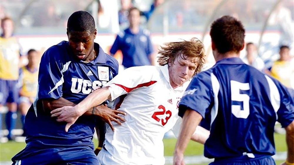The Hoosiers' Peterson fights with UCSB defender Andy Iro for a loose ball in the NCAA title game in 2004. Peterson was IU's lone goal scorer in the game.