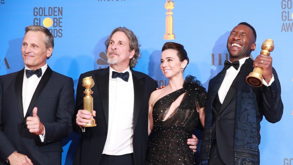 """The cast and director of """"Green Book,"""" from left, Viggo Mortensen, director Peter Farrelly, Linda Cardellini and Mahershala Ali backstage at the 76th Annual Golden Globes on Jan. 6 at the Beverly Hilton Hotel in Beverly Hills, California."""