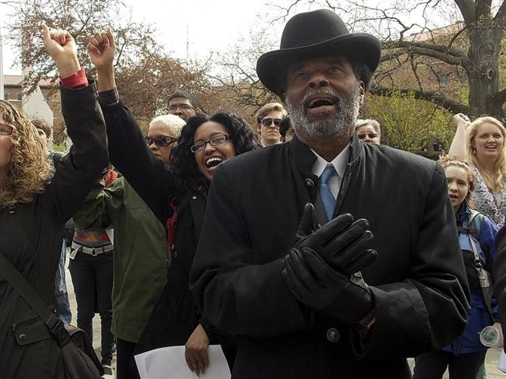 Indianapolis Concerned Clergy Reverend Mmoja Ajabu cheers along with Purdue students for more diversity and less acts of hatred Friday in front of Hovde Hall at Purdue University.