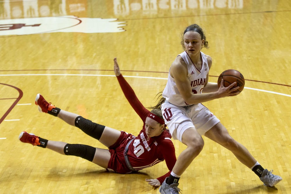 <p>Junior guard Grace Berger works around a Wisconsin defender Jan. 10 in Simon Skjodt Assembly Hall. The Hoosiers will take on Ohio State at 8 p.m. Thursday at Simon Skjodt Assembly Hall. </p>