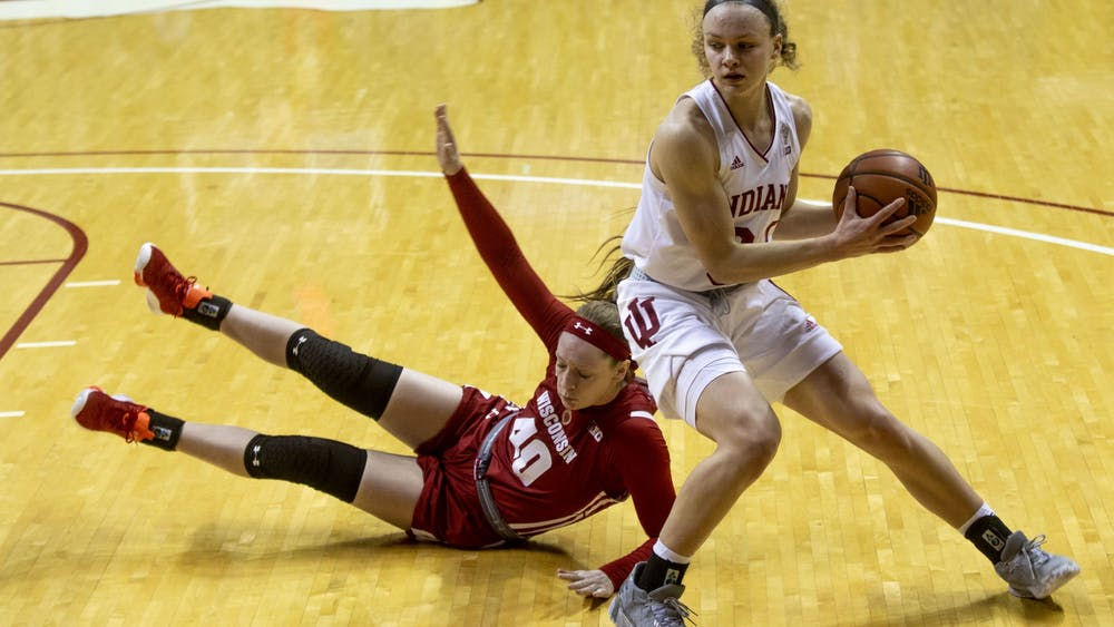 Junior guard Grace Berger works around a Wisconsin defender Jan. 10 in Simon Skjodt Assembly Hall. The Hoosiers will take on Ohio State at 8 p.m. Thursday at Simon Skjodt Assembly Hall.