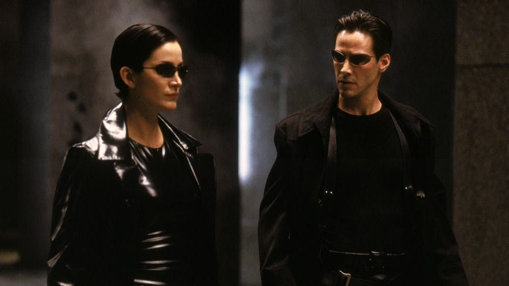 """Carrie-Anne Moss and Keanu Reeves star in """"The Matrix."""""""