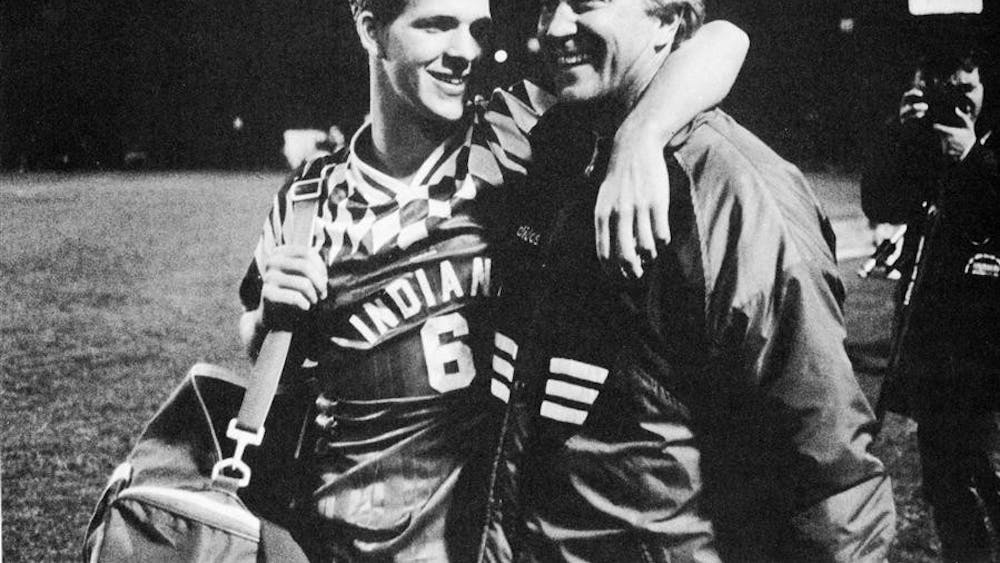 Then-IU coach Jerry Yeagley and his son Todd, now the coach of the Hoosiers, celebrate after beating UCLA at the College Cup in 1994.