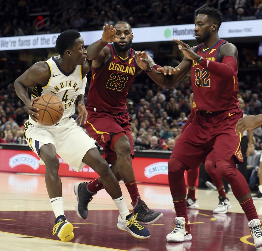<p>The Indiana Pacers' Victor Oladipo is defended by Cleveland Cavaliers' LeBron James and Jeff Green in the first quarter at Quicken Loans Arena in Cleveland on Wednesday, Nov. 1, 2017. Oladipo, and IU alumnus, was named the NBA's Most Improved Player on June 25.</p>
