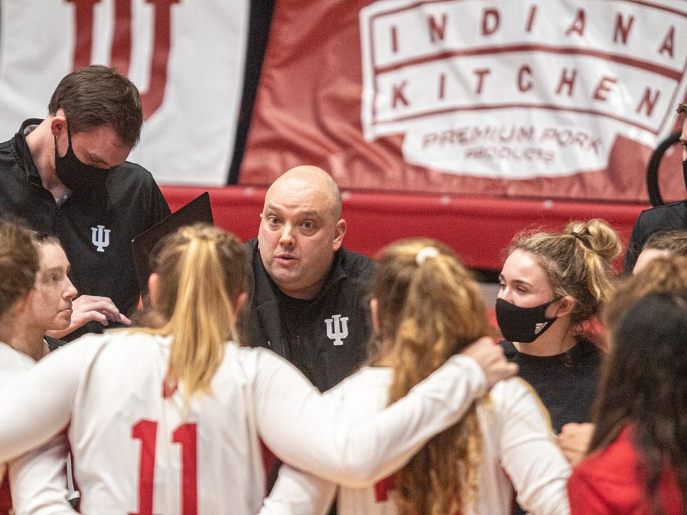 Head coach Steve Aird talks to his team during a break in the action Feb. 12 at Wilkinson Hall. IU lost to Penn State on the road 0-3 on Saturday.