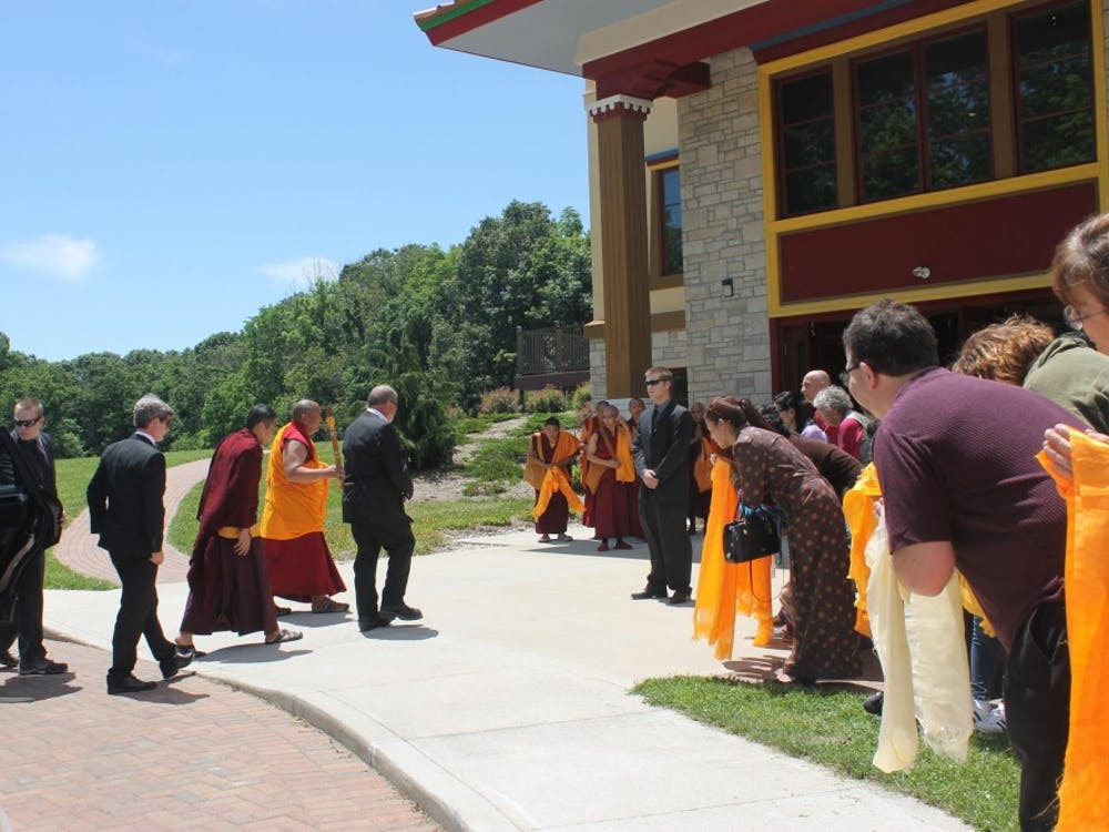 Buddhism students hold Khata to welcome the visit of Kyabje Trijang Chocktrul Rinpoche in front of Gaden Khachoe Shing Monastery.