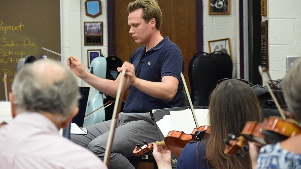 Artistic director Adam Bodony conducts the Bloomington Symphony Orchestra in a string rehearsal Sept. 15, 2015, in the orchestra room of Bloomington High School South.