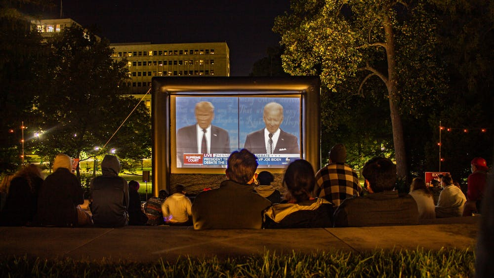 People watch the presidential debate on Sept. 29 at the Conrad Prebys Amphitheater on IU's campus.  Tuesday night's debate was the first of the presidential debates.