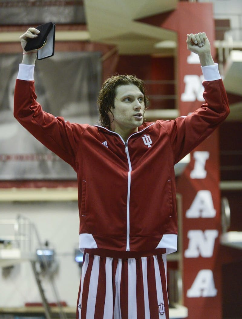 Junior Cody Miller celebrates after being awarded the Gold medal for his participation in the 200-yard Breaststroke event March 2, 2013 at the Counsilman-Billingsley Aquatic Center. The event, in which Miller placed first with a record-setting time of 1:51.03, was part of the Big 10 Men's Swimming and Diving Championships.