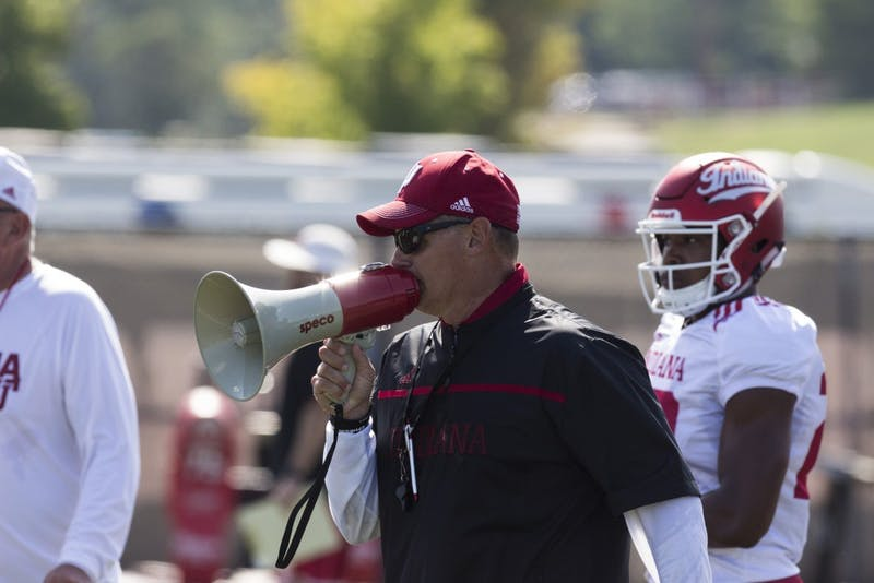 IU football Coach Tom Allen yells instructions into a megaphone during practice at the IU Football practice fields. The Hoosiers have opened their 2018 season with a 3-0 record.