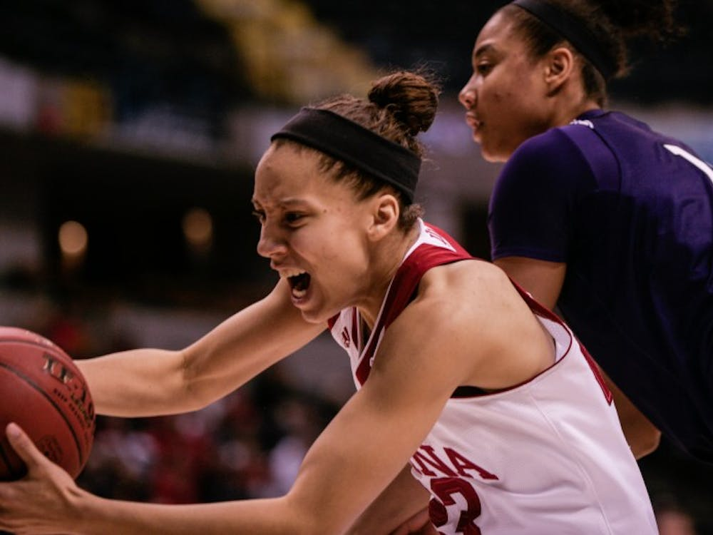 Junior guard Alexis Gassion grabs the ball before it goes out of bounds. The Hoosiers lost 73-79 to Northwestern on Friday at Bankers Life Fieldhouse in Indianapolis.