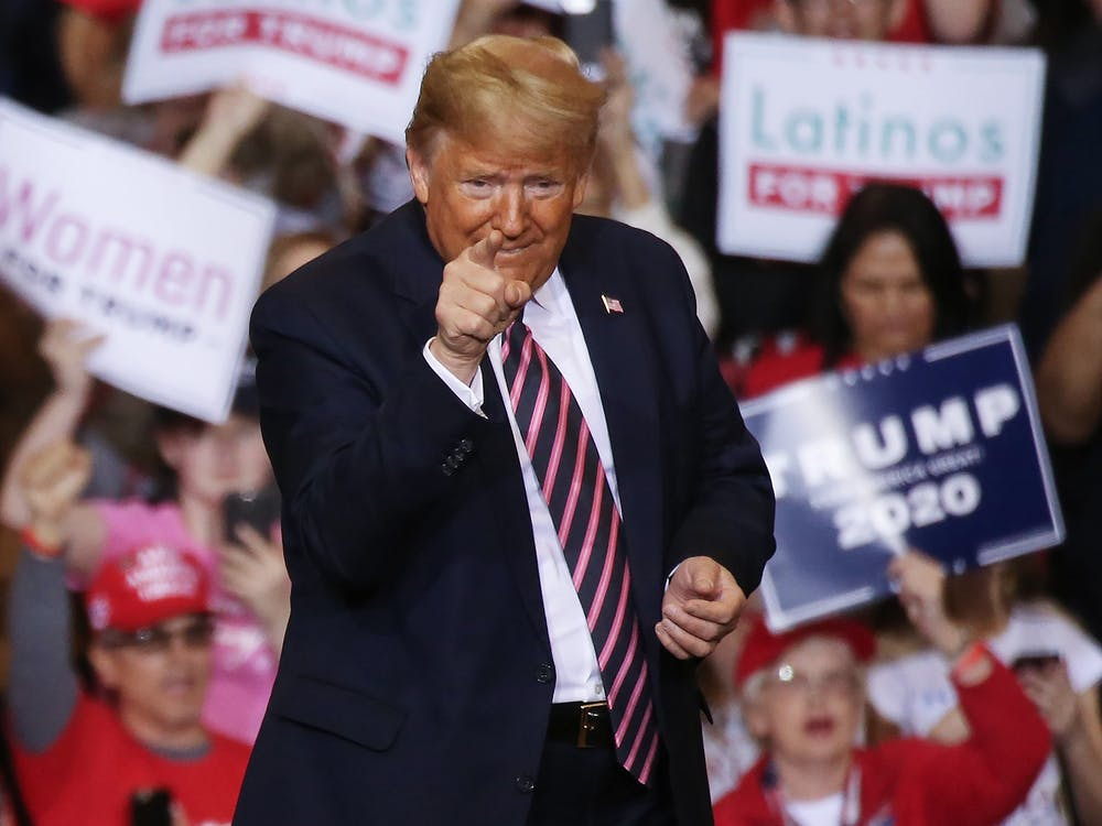 President Donald Trump gestures during a campaign rally Feb. 21 at the Las Vegas Convention Center in Las Vegas.