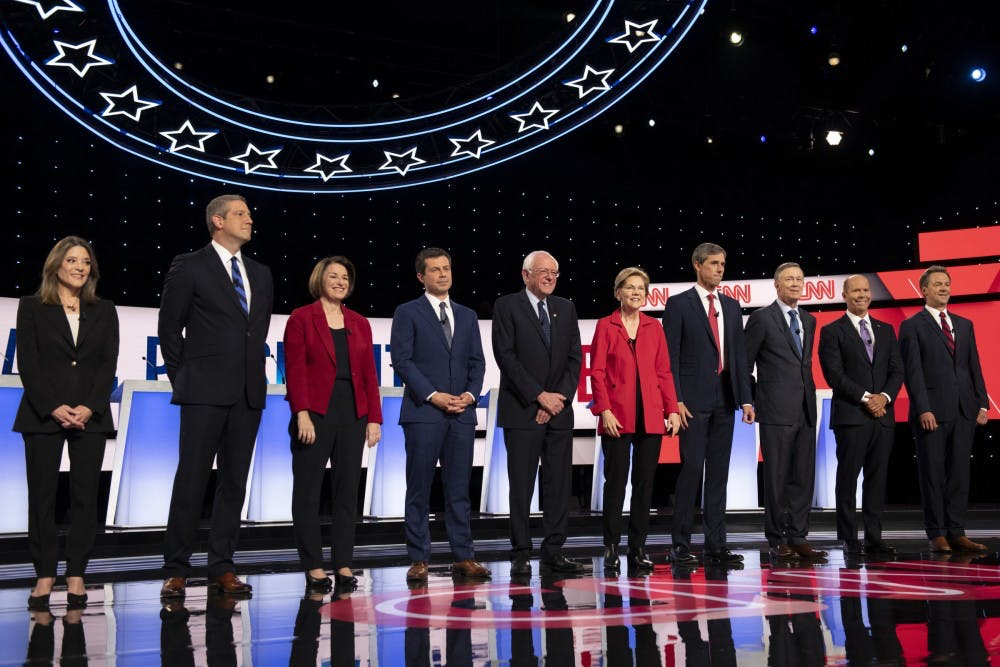 <p>Democratic primary candidates stand before the start of the second Democratic primary debate July 30 at the Fox Theatre in Detroit. The next debate will take place Thursday in Houston.</p>