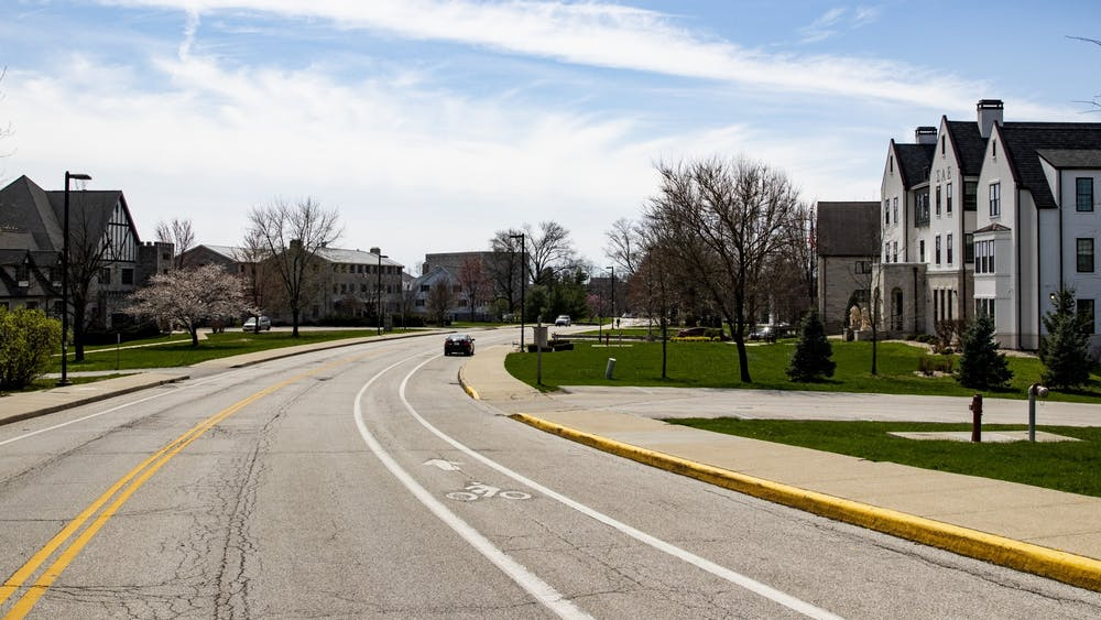 A car sits parked March 30 on North Jordan Avenue. The Monroe County Health Board said in a meeting Tuesday it will begin to take action against IU greek houses that are not in compliance with the maximum capacity regulations.