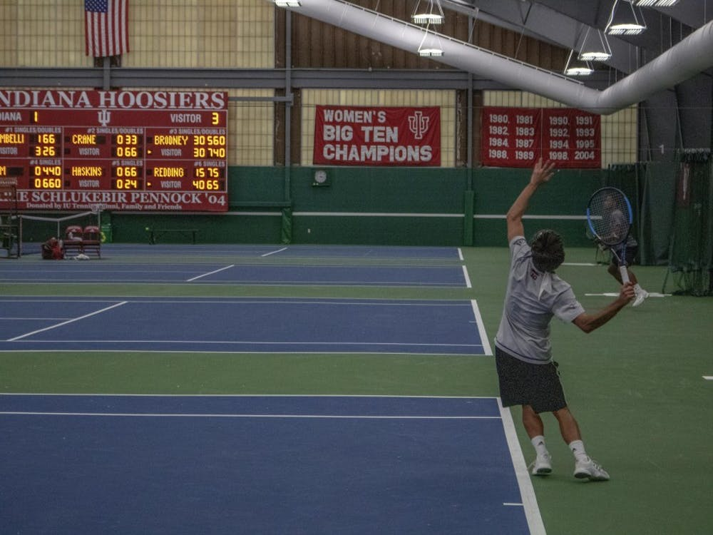 IU senior Antonio Cembellin serves against Arizona State University on Feb. 10 at the IU Tennis Center.