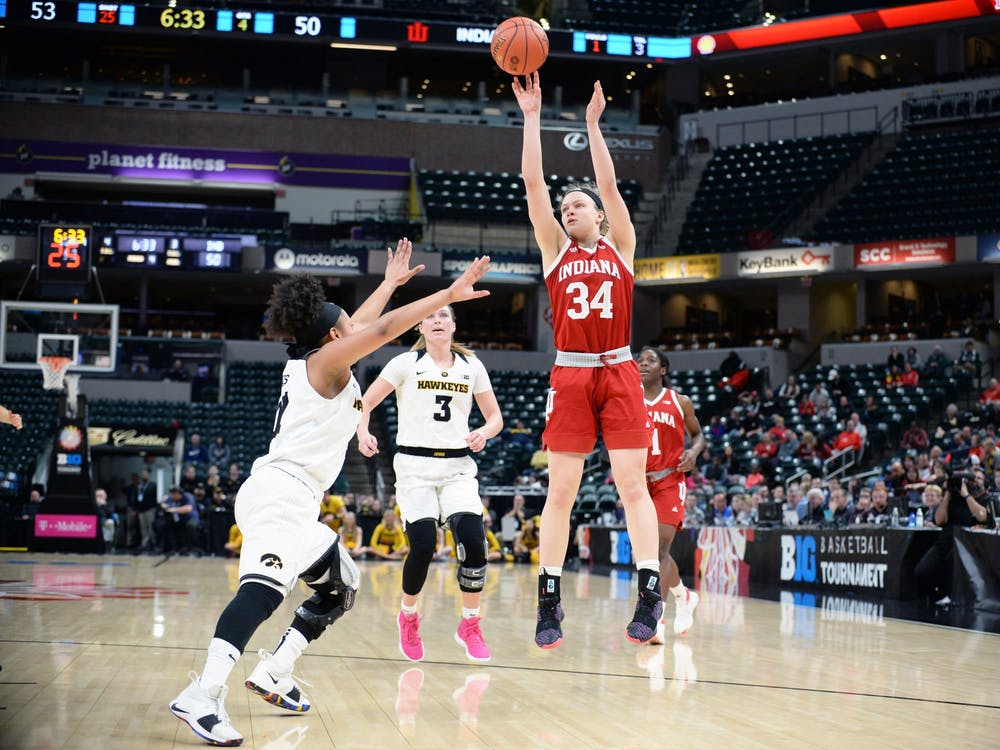 Freshman guard Grace Berger shoots the ball during IU's third round Big Ten Tournament game against Iowa on March 8 in Bankers Life Fieldhouse in Indianapolis. The IU women's basketball team was ranked No. 24 in the nation, according to the Associated Press top-25 preseason poll released Wednesday.