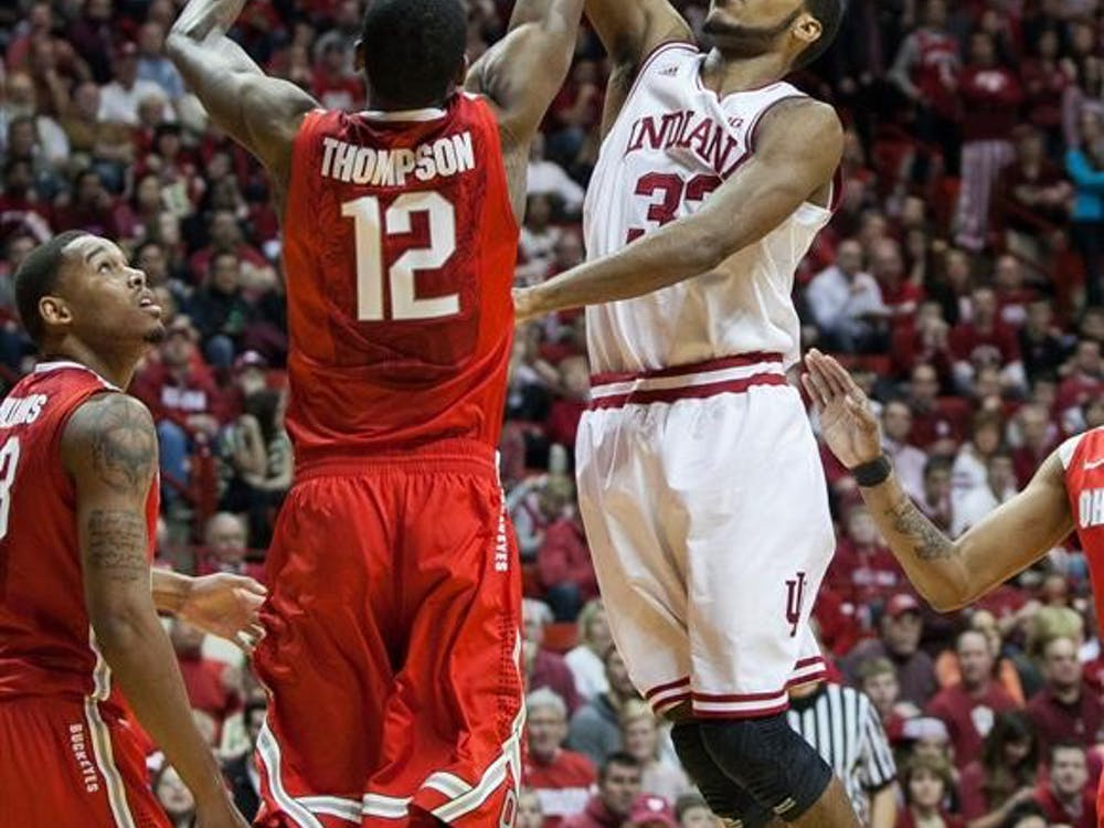 Forward Jeremy Hollowell shoots over an Ohio State defender on Sunday at Assembly Hall. Indiana won 72-64.