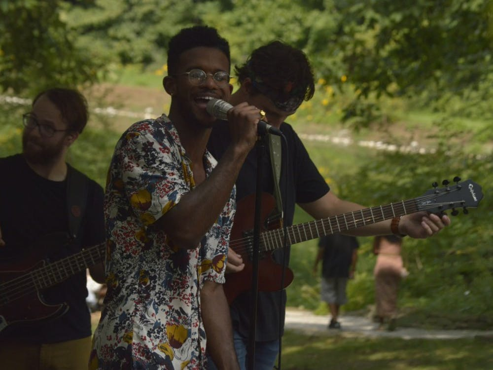 Dexter Clardy of Huckleberry Funk sings as Mike Gronsky and Matt McConahay play guitar and bass behind him. The band performed Aug. 18 at Oliver Winery.