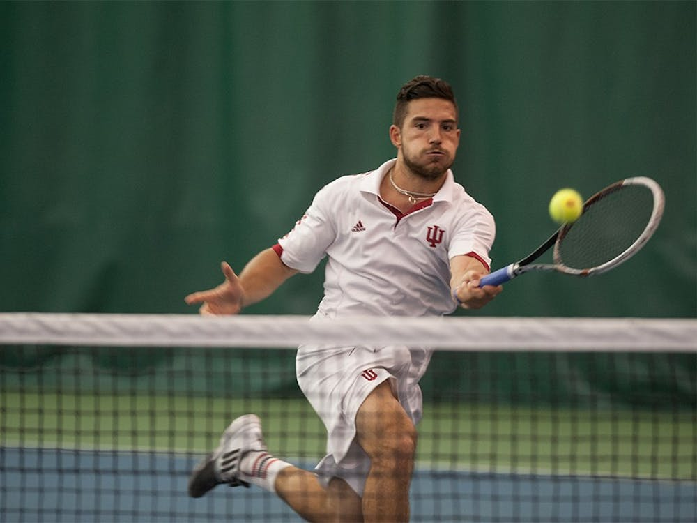IU senior Sam Monette rushes towards the net to hit a forehand shot against Gijs Linders, a senior from Michigan State University, on April 20, 2015. at the IU Tennis Center. Monette lost the match 6-1, 3-6, 2-6.