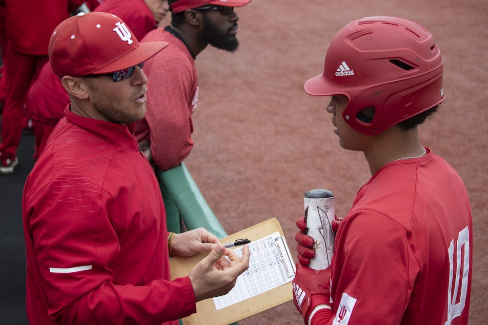 <p>Then-sophomore infielder Justin Walker talks to baseball head coach Jeff Mercer during the 2019 season at Bart Kaufman Field. New commit Tank Espalin received a prospect grade of 10 from Perfect Game, a scouting organization.</p>