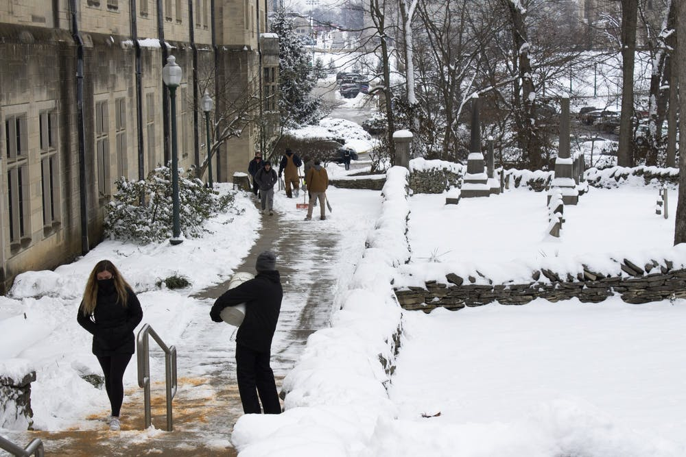 <p>IU employees salt sidewalks Feb. 10 outside of the Indiana Memorial Union. Bloomington is expected to get up to one foot of snow between Sunday evening and Tuesday morning, according to the National Weather Service. </p>