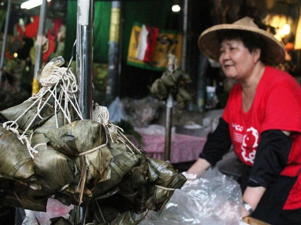 A woman sells the Zongzi she's made herself at the local market at the Central Market in Pingtung City.