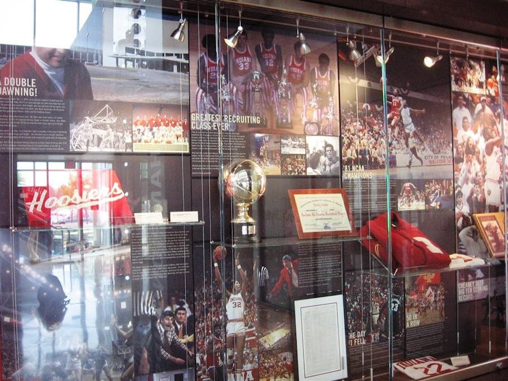 The Assembly Hall Era Case, displaying many of the most notable photographs and artifacts, inside Phau Shine Legacy Court. The other side of the room is also home to the Field House Era case.