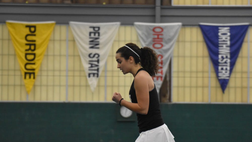 """Then-freshman Andjelija """"Jelly"""" Bozovic celebrates after winning a point during one of her singles matches against the University of Cincinnati."""