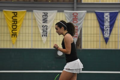 "Then-freshman Andjelija ""Jelly"" Bozovic celebrates after winning a point during one of her singles matches against the University of Cincinnati."