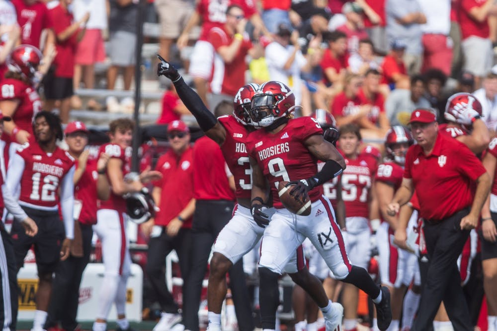 <p>Senior defensive back Marcelino McCrary-Ball celebrates his interception in the first quarter of the game against the University of Cincinnati on Sept. 18, 2021, at Memorial Stadium. Indiana will travel to face the Western Kentucky University Hilltoppers on Sept. 25, 2021, in Bowling Green, Kentucky.</p>