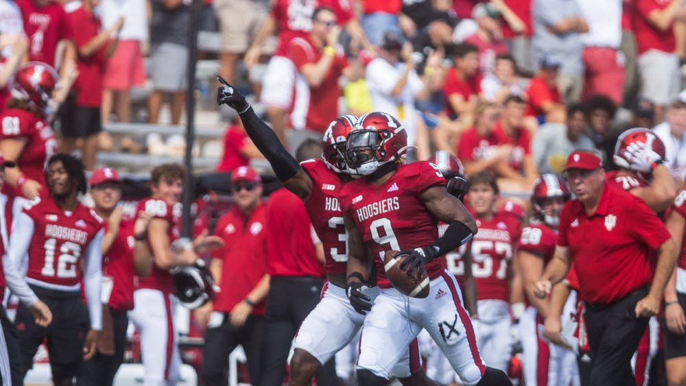 Senior defensive back Marcelino McCrary-Ball celebrates his interception in the first quarter of the game against the University of Cincinnati on Sept. 18, 2021, at Memorial Stadium. Indiana will travel to face the Western Kentucky University Hilltoppers on Sept. 25, 2021, in Bowling Green, Kentucky.