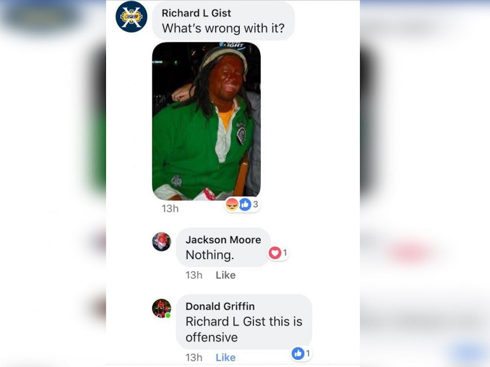 Richard Gist, a Brown County High School coach and substitute teacher, faced backlash after posting a Facebook photo of himself wearing blackface, which can be seen in the screenshot above. Brown County Schools has since fired Gist.
