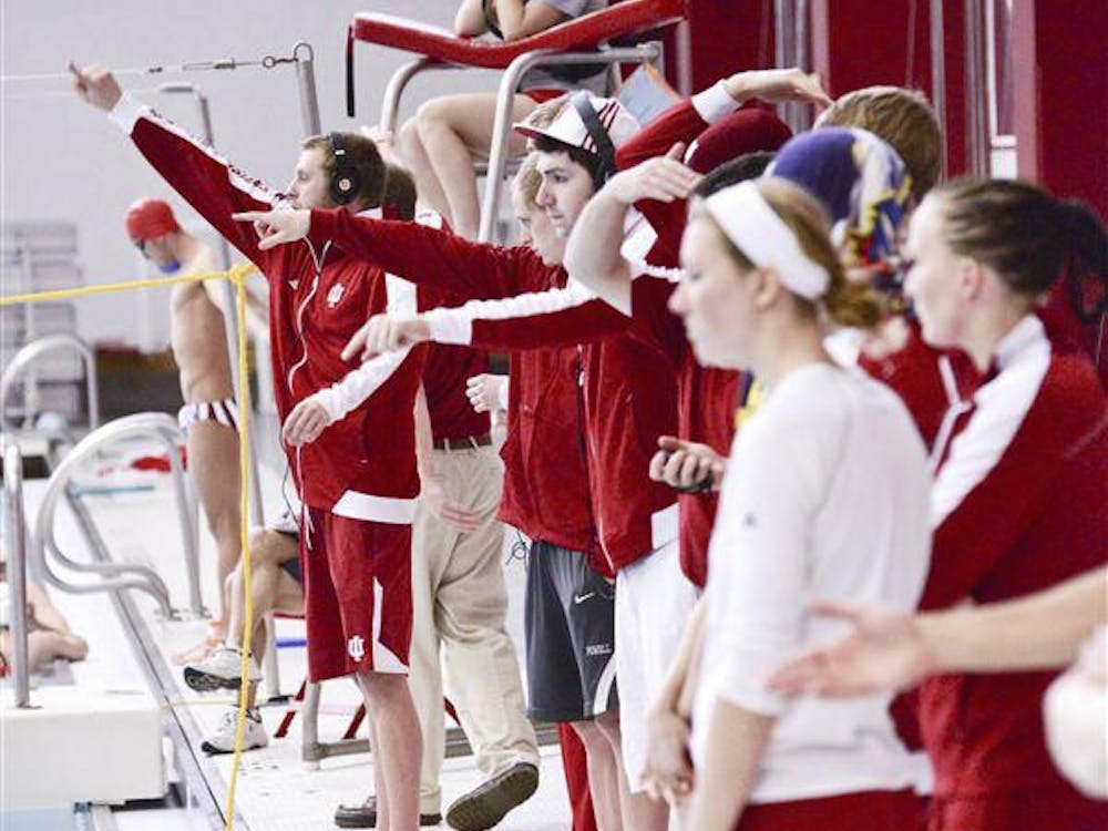 IU swimming and diving teams cheer on teammates during the men's 1000-yard freestyle on Jan. 19 at the Councilman-Billingsley Aquatic Center.