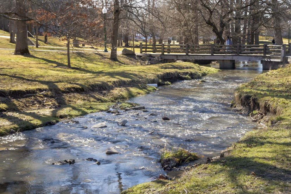 <p>High waters appear in the Campus River on Monday. A flood warning has been issued until Thursday for Monroe County, according to the National Weather Service. </p>