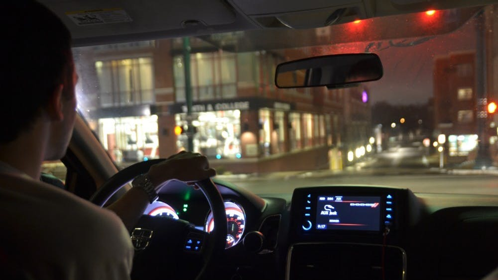 Tanner Smith drives Jan. 16, 2019, for the IU Safety Escort service through downtown Bloomington.