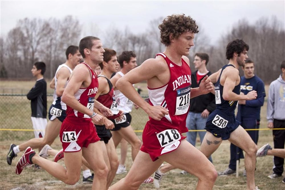 Then-sophomore Nate Morrow and then-junior Andy Weatherford run in a pack during the NCAA Cross Country Championships.