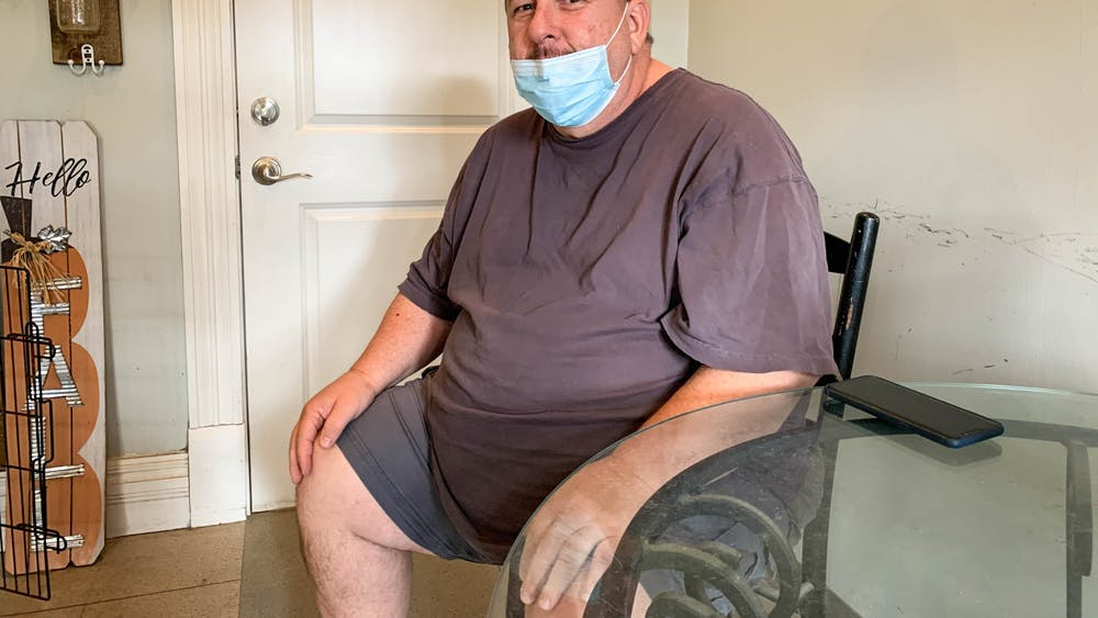 Steve Moore sits Oct. 17 in Waggin Tails Pet Grooming. Steve and Saundra own the small dog grooming business.