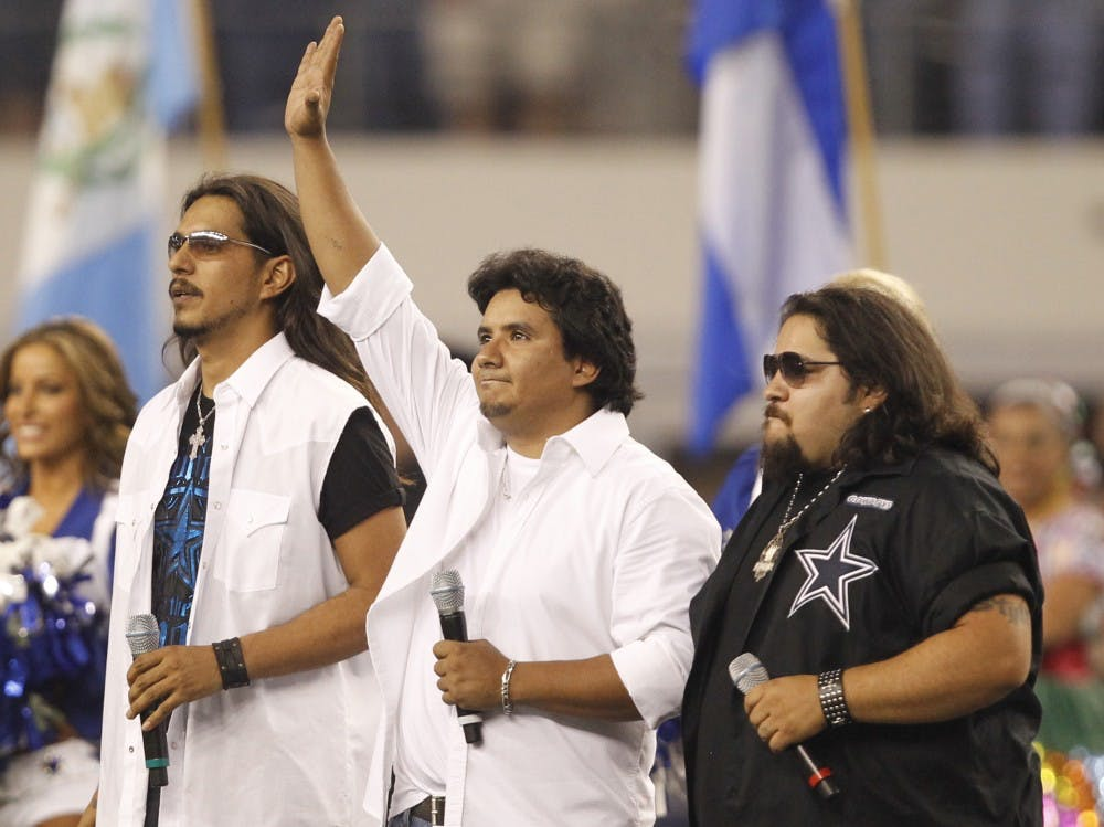 <p>Los Lonely Boys perform before the start of an NFL game in 2011 in Arlington, Texas. The band will perform March 19 at the Buskirk-Chumley Theater. </p>