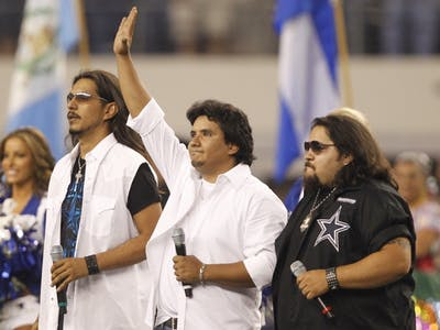 Los Lonely Boys perform before the start of an NFL game in 2011 in Arlington, Texas. The band will perform March 19 at the Buskirk-Chumley Theater.