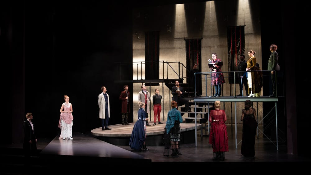 """The cast of """"Hamlet"""" stands on stage Dec. 3, 2019, during the first act in the Ruth N. Halls Theatre. Director Jonathan Michaelsen cast more women than men in this production of """"Hamlet."""""""