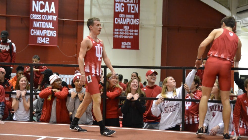 Kyle Mau and Daniel Michalski celebrate Jan. 25 with teammates after the men's distance medley at the Indiana University Relays at Gladstein Fieldhouse. As a junior, Mau led the IU men's cross-country team to an 18th-place finish in the nation.
