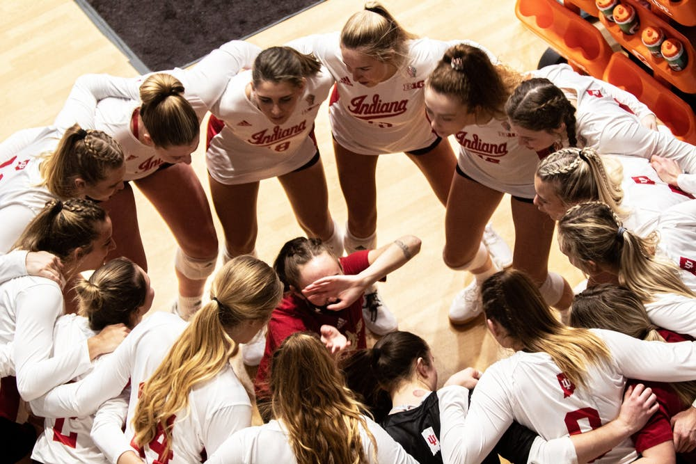 <p>IU volleyball players circle up before a match Feb. 13 in Wilkinson Hall. The Hoosiers will play a double header this weekend against Michigan in Ann Arbor, Michigan. </p>